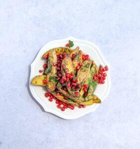 תפוחי אדמה צרובים עם ויניגרט שום ורימונים צילום: אסי רוזיצנר